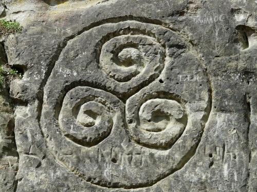 Ancient triskelion carving