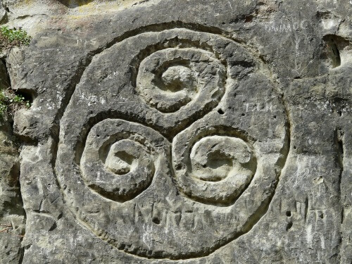 Ancient triskelion carving