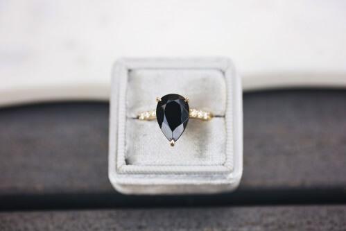 black diamond ring pear cut in a box
