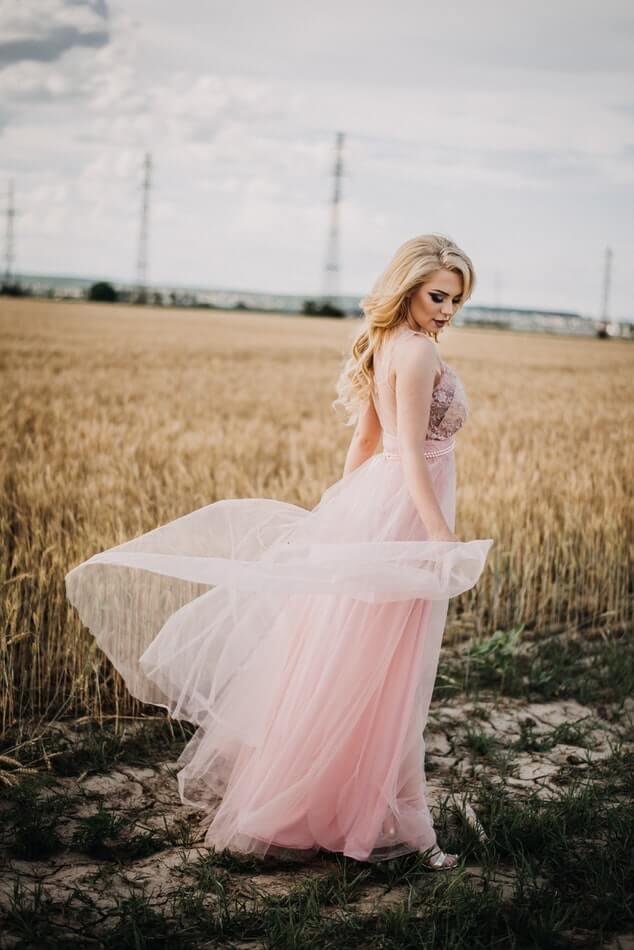 Girl wearing blush wedding dress