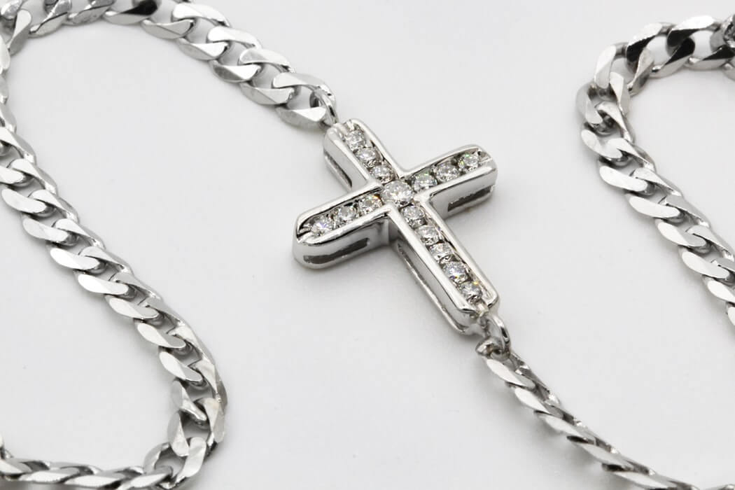 Cross symbol in a necklace