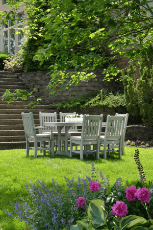 Dining table setup in a green field