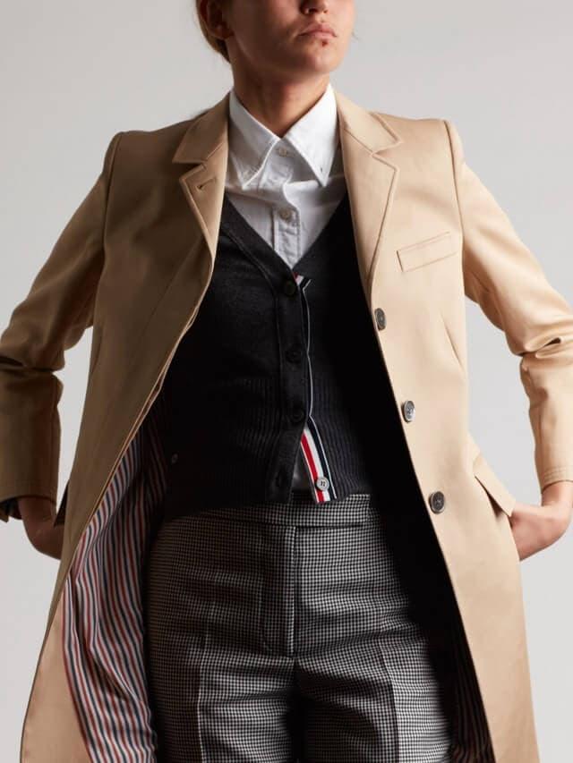 Man wearing beige suit