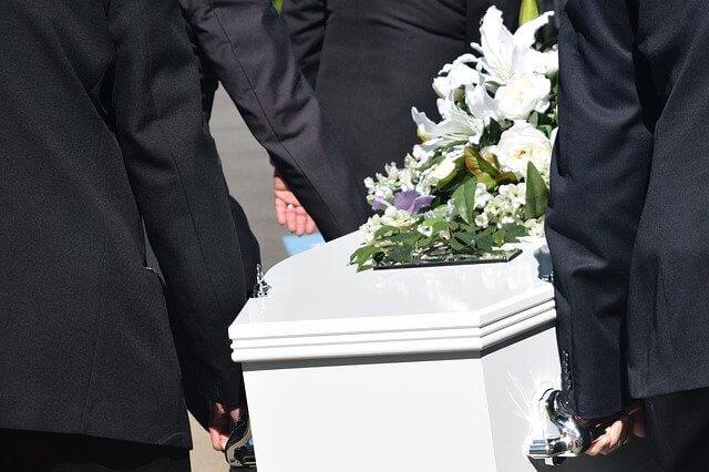 Men carrying casket black