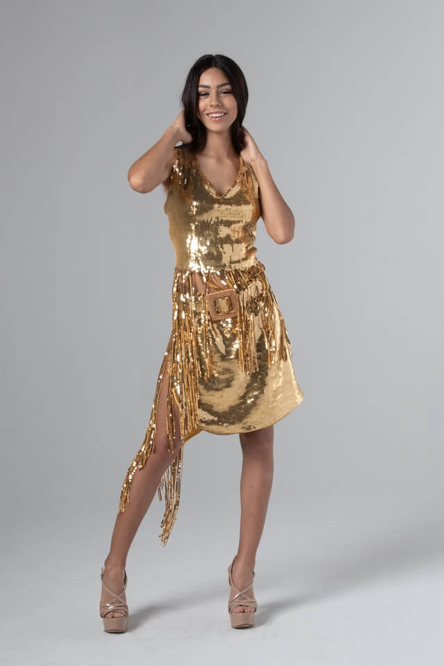 Girl wearing gold color dress