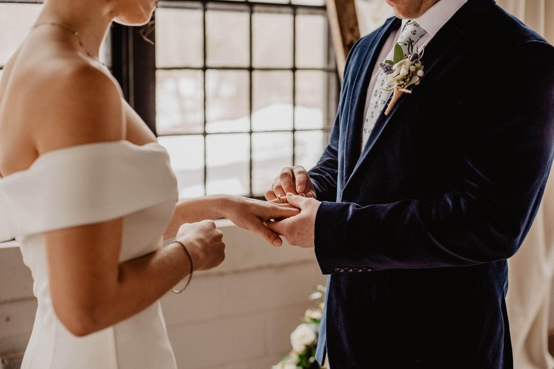 putting finger on ring wedding ceremony