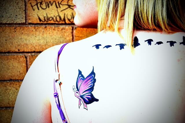 butterfly tattoo on woman's back