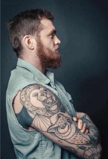 Man with owl tattoo