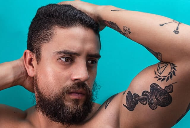 Snake tattoo on arm man