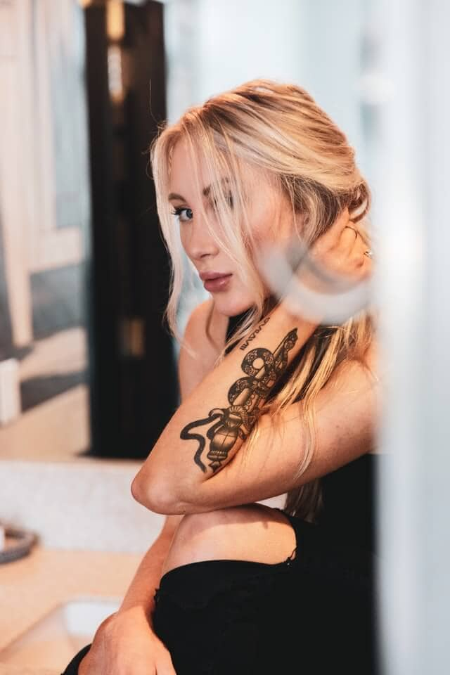 Snake tattoo on arm woman