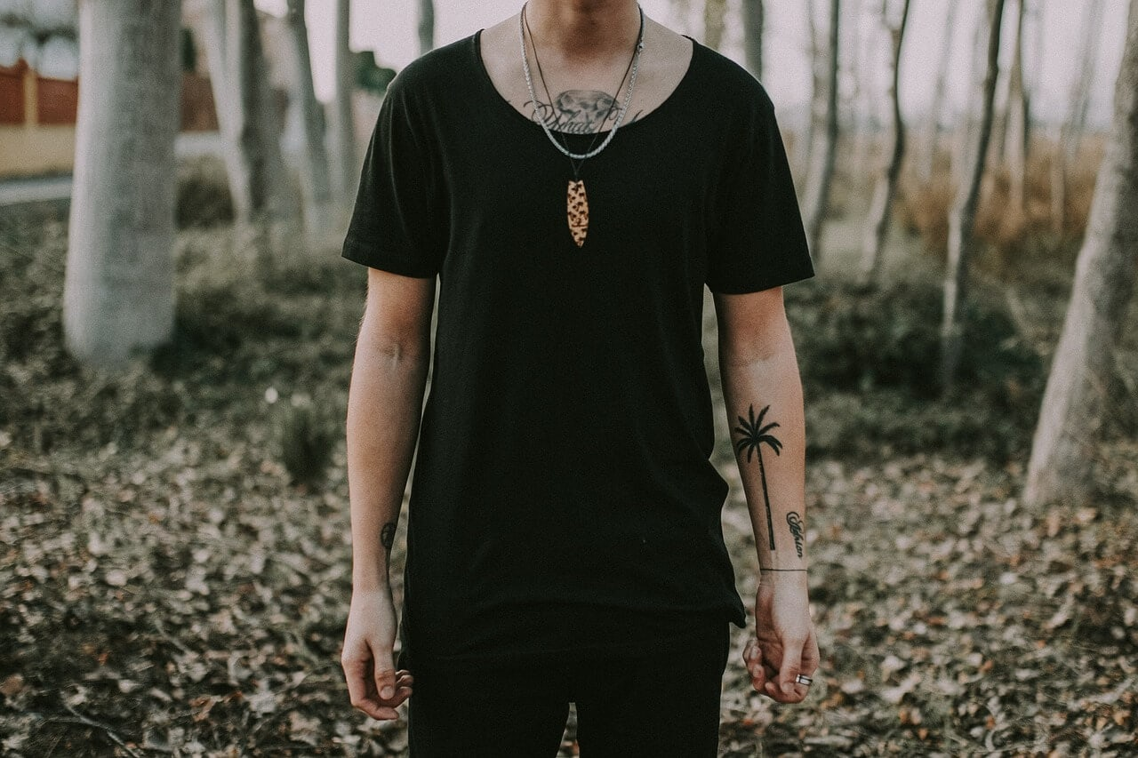Man with tree tattoo on his arm