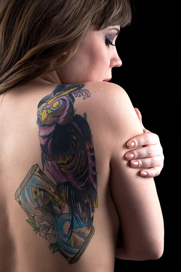 Woman with owl tattoo
