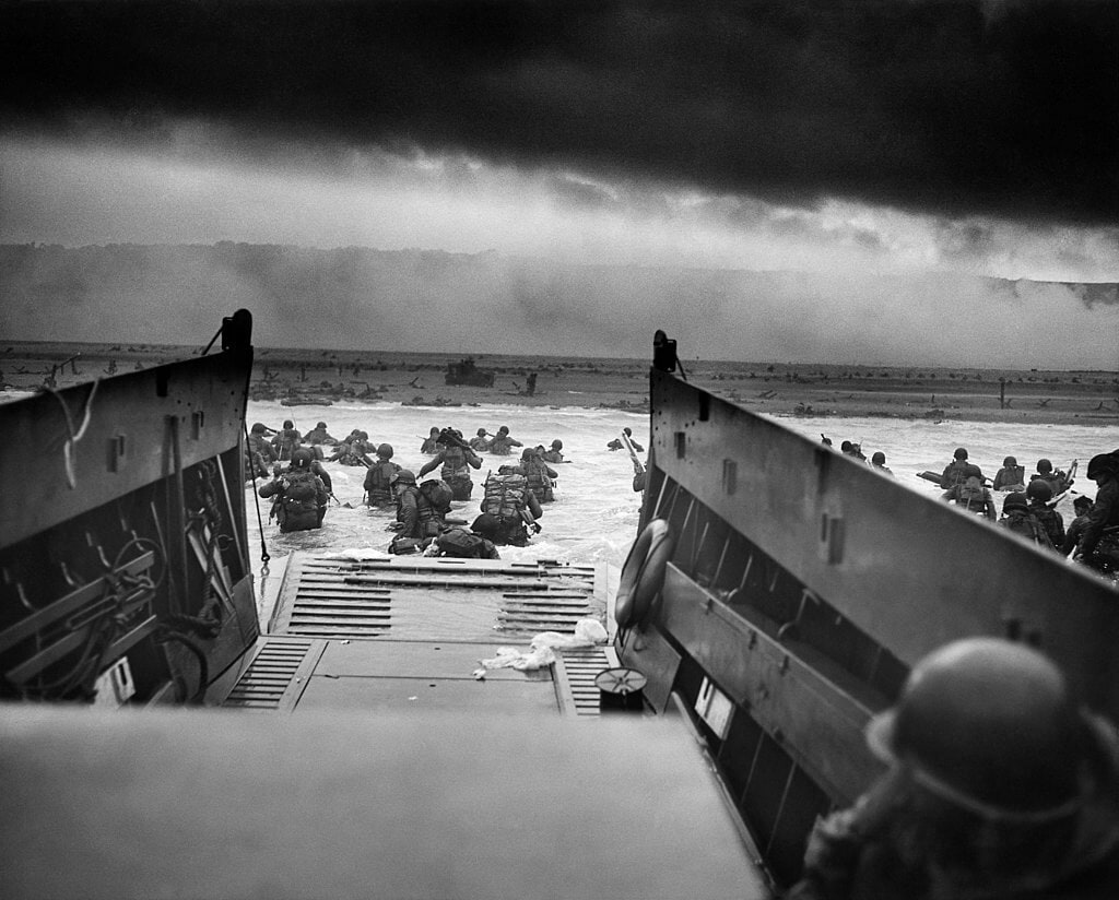 Troops wading into the Omaha Beach from the USS Samuel Chase