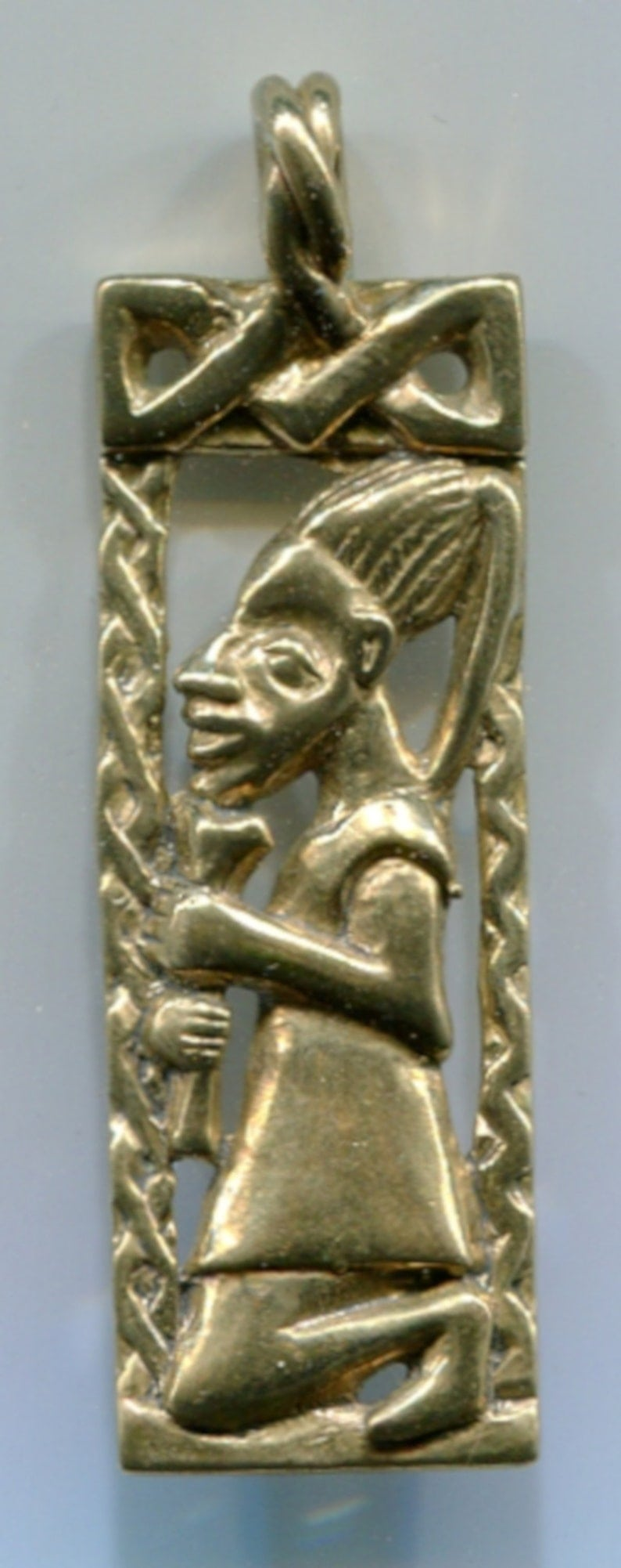 Gold pendant Eshu