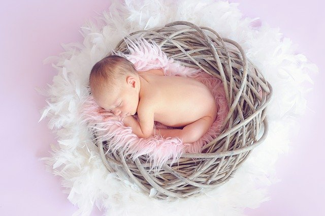 Baby girl in a basket